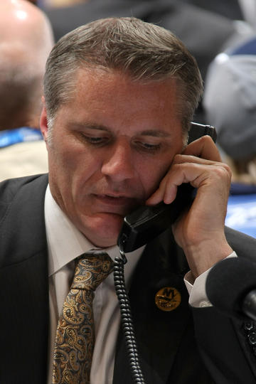 LOS ANGELES, CA - JUNE 25:  General Manager Garth Snow of the New York Islanders on the phone during the 2010 NHL Entry Draft at Staples Center on June 25, 2010 in Los Angeles, California.  (Photo by Dave Sandford/NHLI via Getty Images)
